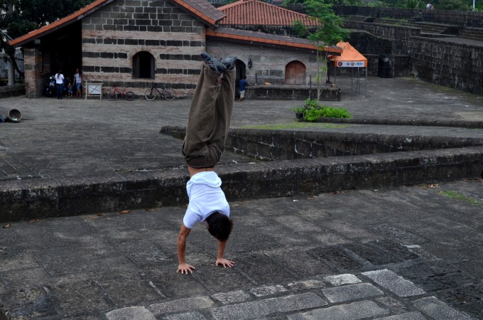 A young man warming up before a parkour training