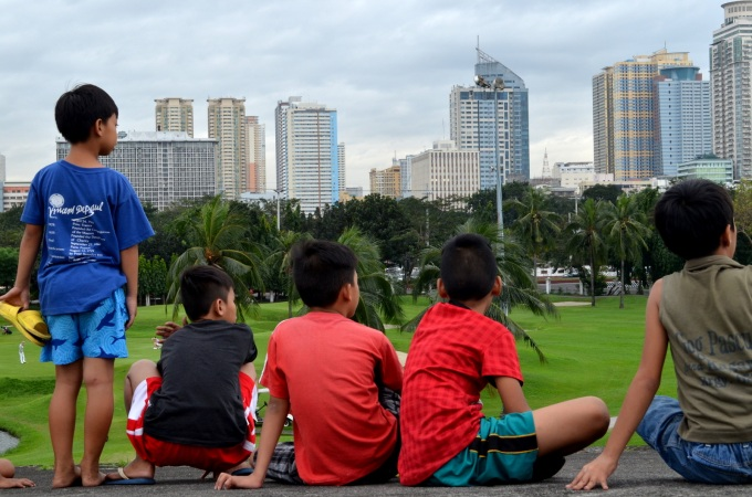 Children above the ramparts of Intramuros