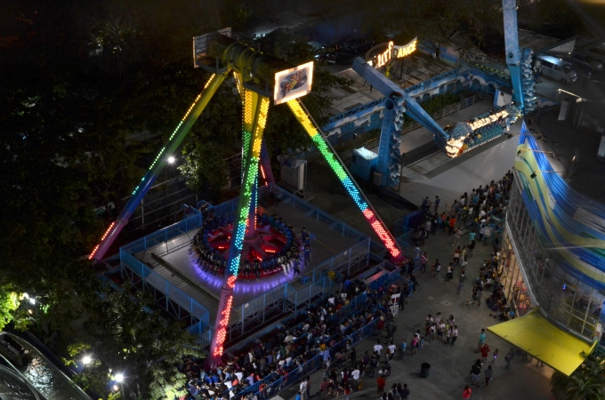 Atop a Ferris wheel, I could see merry-making people scattered around the amusement park